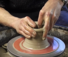 Making / Throwing a ceramic clay pottery Apple on the wheel
